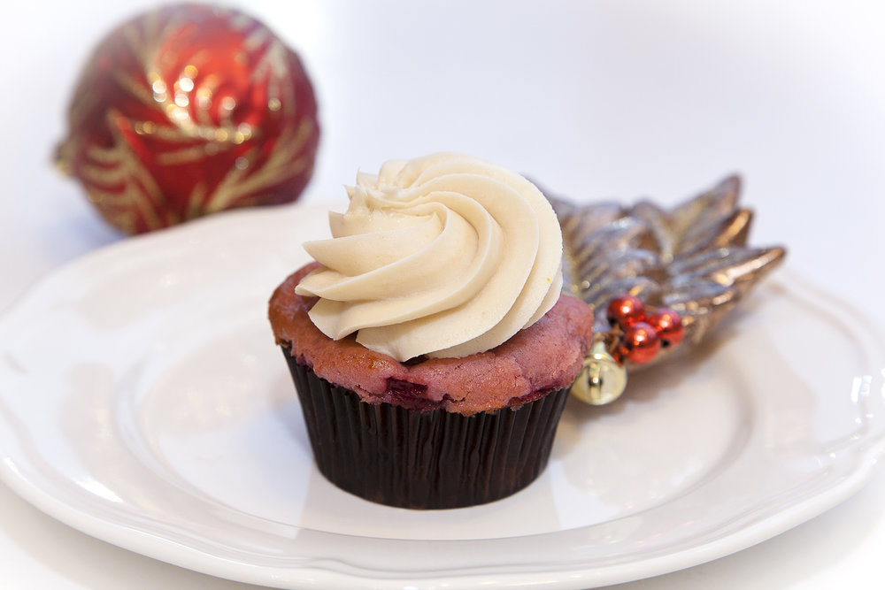 Cranberry & Orange Curd Cupcake $4.5  - Tart and sweet in perfect harmony. Cranberry cake with an orange curd filling and topped with orange curd swirled cream cheese frosting.