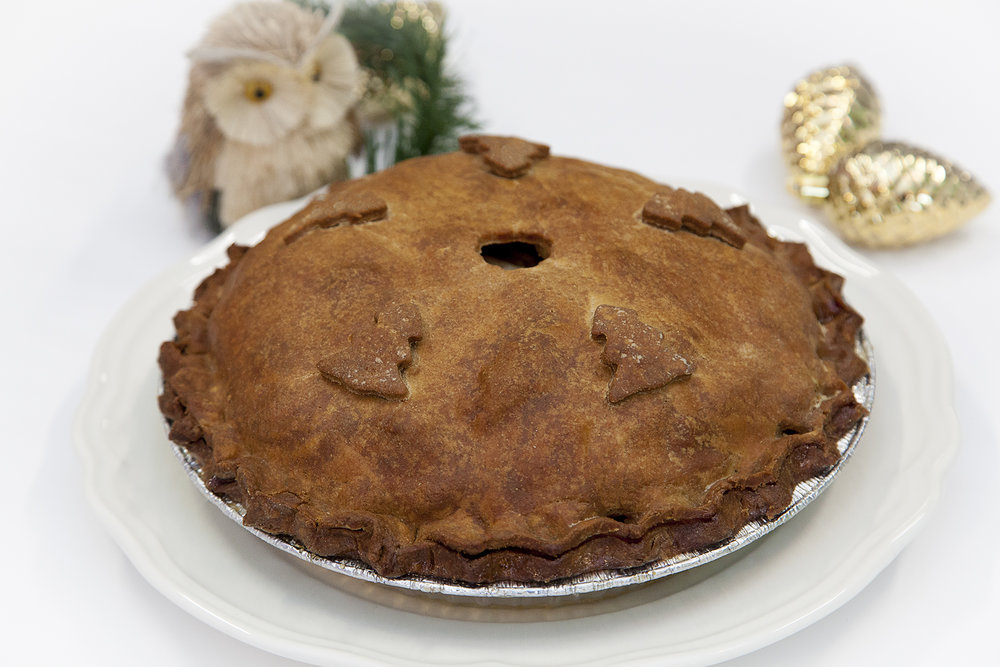 Apple Pie $28 -  Bunner's classic apple cinnamon pie, gorgeously decorated in an evergreen theme using Bunner's famously flaky, perfectly browned pie crust.