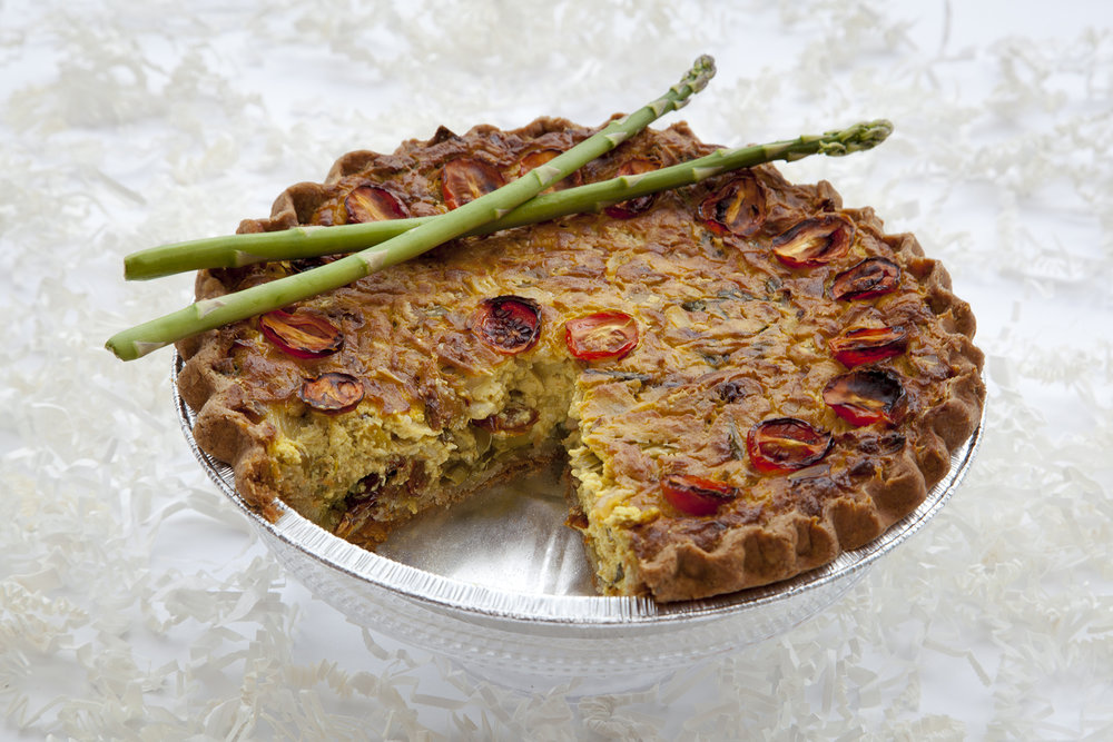Asparagus & Sun Dried Tomato Quiche $28 -  So tender, so savoury... This miracle of invention speaks to Bunner's passion for turning food restrictions into an outright benefit! Beautifully crimped pastry wraps this tumeric & tofu based quiche - packed with asparagus, pepper jack Daiya, leeks, sun dried tomatoes and topped with oven roasted cherry tomatoes.