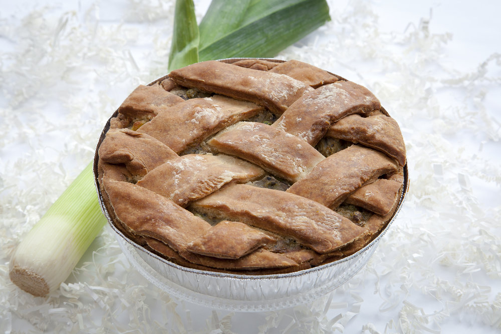 Fennel & Leek Spring Pie $30 -  Our classic deep dish Spring Pie sings the turning of the season with every bite! A delicate balance of fresh fennel and leeks are the perfectly lite savoury combination as you dream of budding leaves and a warm spring breeze.