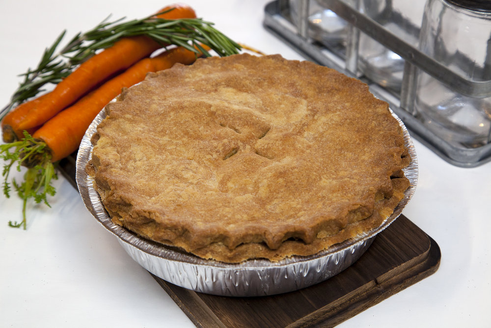 "!!All New!!  Oven Roasted Harvest Vegetable 'Chicken' Pot Pie*  - 8"" Deep Dish (to order) and 4"" in stores daily. We've been selling Veggie Pot Pies for a while now, but never like this. Caramelized mushrooms, carrots, corn and more are paired with savoury, oven roasted 'chicken' strips and unified with a heaping ladle of perfectly seasoned gravy.   *Contains Soy"