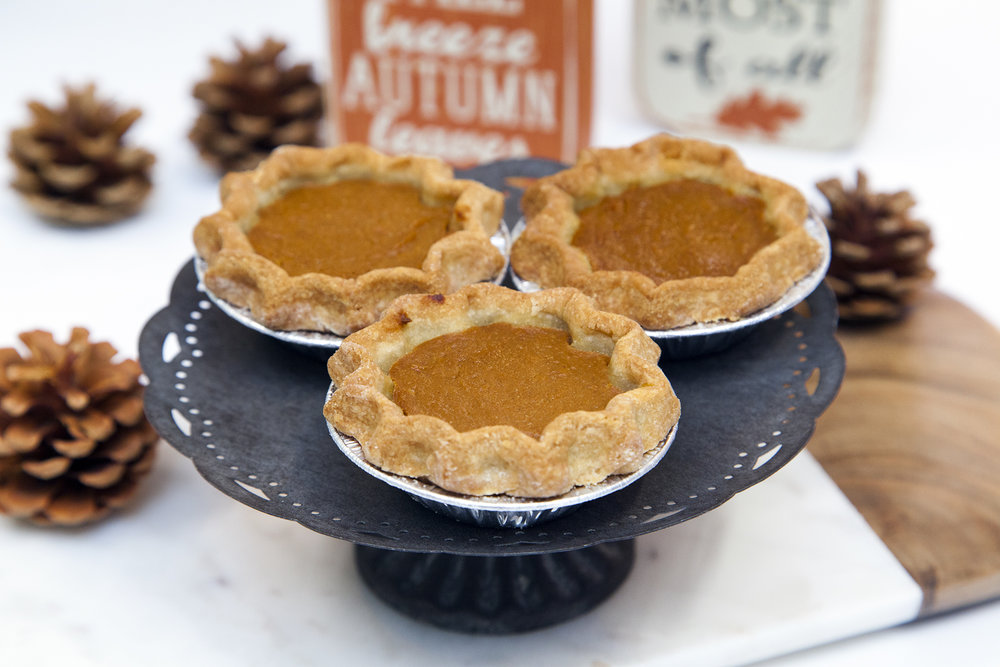 Mini Pumpkin Pie  - The same creamy, spicy, baked goodness of our full size Pumpkin Pie but in a perfectly personal mini size. Excellent for a self serve dessert table or to place beside each guest's plate!  Allergens: Soy