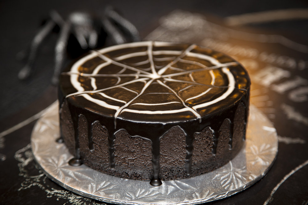 🕷BLACK WIDOW🕷:  Choose your slice carefully as you never know when the black widow will pounce on its prey! A black cocoa cheesecake with black chocolate crumble base and decorated with an eerily crisp, white spider's web.