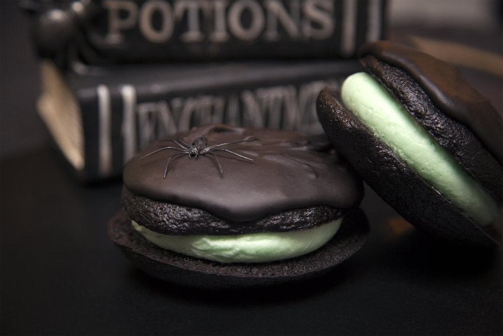 🧟‍♀️JOSA-MEAN LOUISE🧟‍♀️:  The macabre cousin of our famous Josaphine Louise, Josa-Mean only comes to visit the family once a year on, you guessed it, Halloween! Two layers of black chocolate cake sandwiching a cool hearted mint coconut frosting and covered in a thick layer of chocolate ganache. (spiders not included ;)