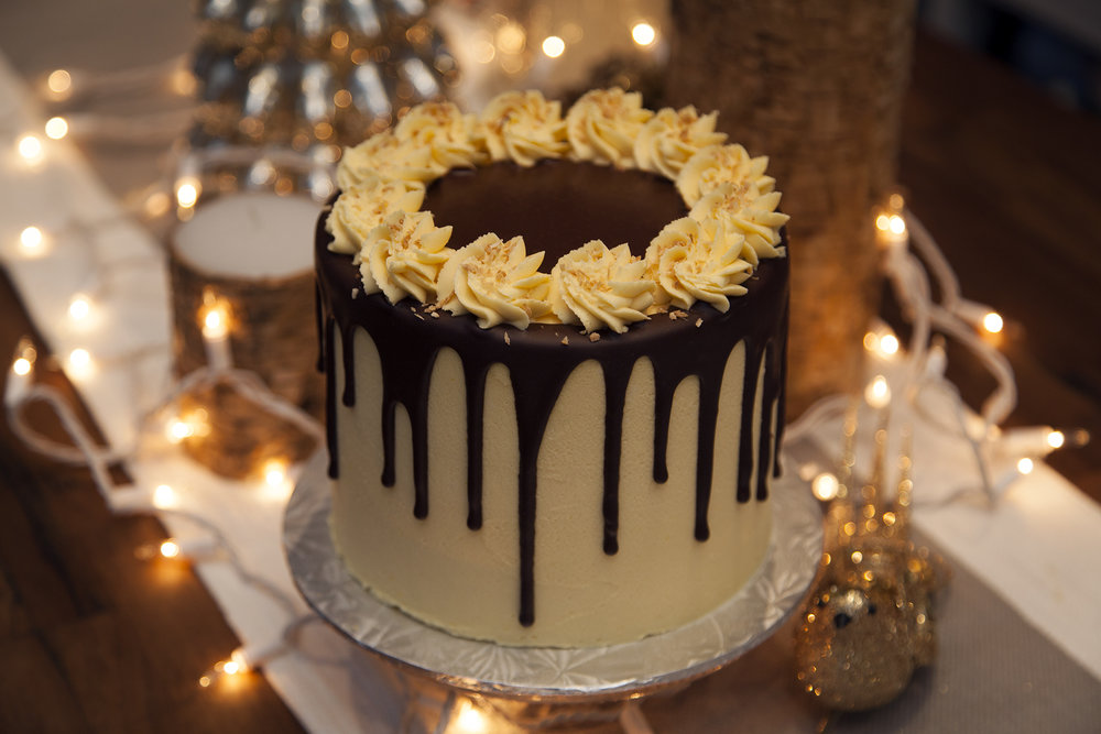 Nanaimo Cake  - Layers of moist chocolate cake infused with coconut and frosted with a thick spread of Bunner's creamy custard flavoured frosting. Topped with our decadent chocolate ganache and a sprinkle of toasted coconut.