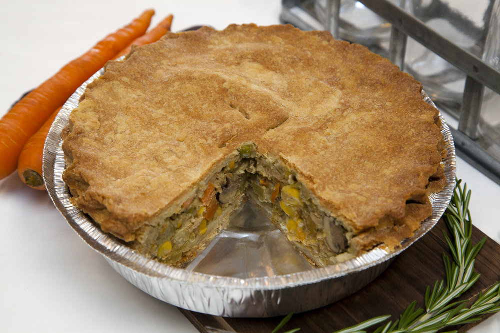 Oven Roasted Harvest Vegetable 'Chicken' Pot Pie*  - We've been selling Veggie Pot Pies for a while now, but never like this. Reformulated from the ground up, this deep dish Pot Pie is packed full of caramelized mushrooms, squash, carrots & corn, paired with savoury, oven roasted 'chicken' strips and unified with a heaping ladle of perfectly seasoned gravy.  *Allergens: Soy   SOY FREE OPTION  - Same as above, but no soy 'chicken' strips and twice the roasted veggies! Please specify in the selection field in our online store.