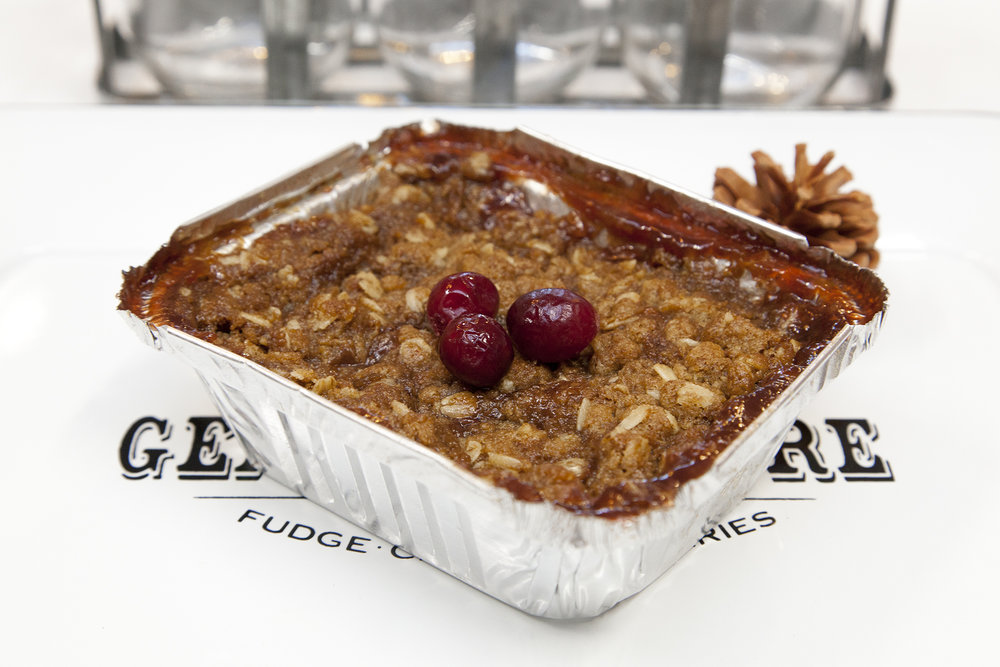 Apple Cranberry Crisp  - A universally loved classic Christmas dessert! Oven baked spicy apples and whole cranberries with a crispy oat crumble on top. Depending on your requirements, we offer this crisp in two convenient size options!