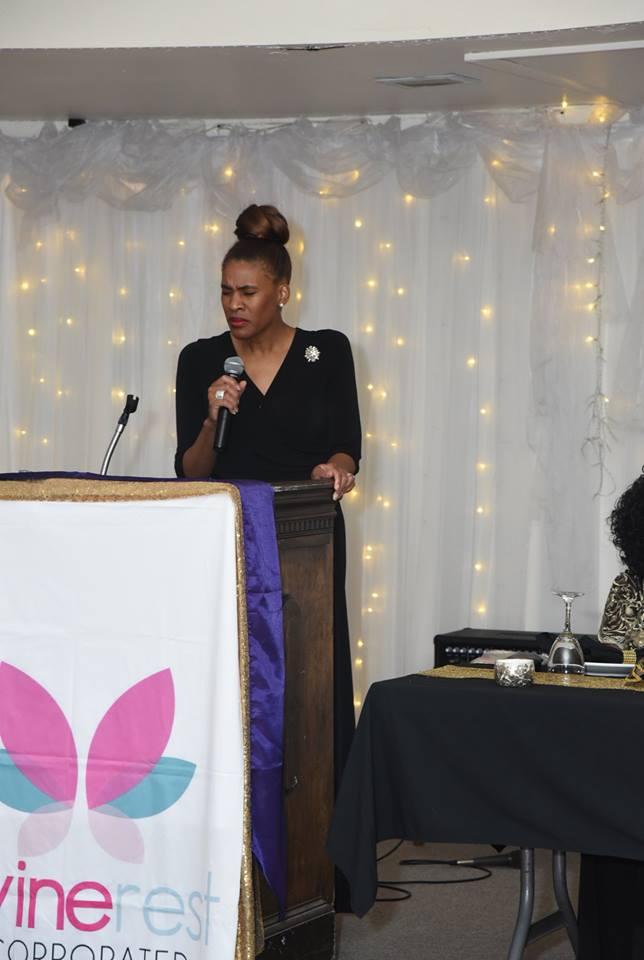 Pastor Tomekia Williams, Impact Church praying over event.