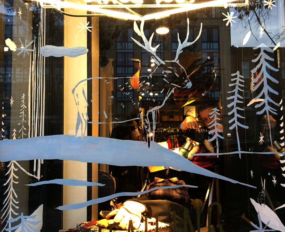 Holiday window painting for the  Filson  store in DC.