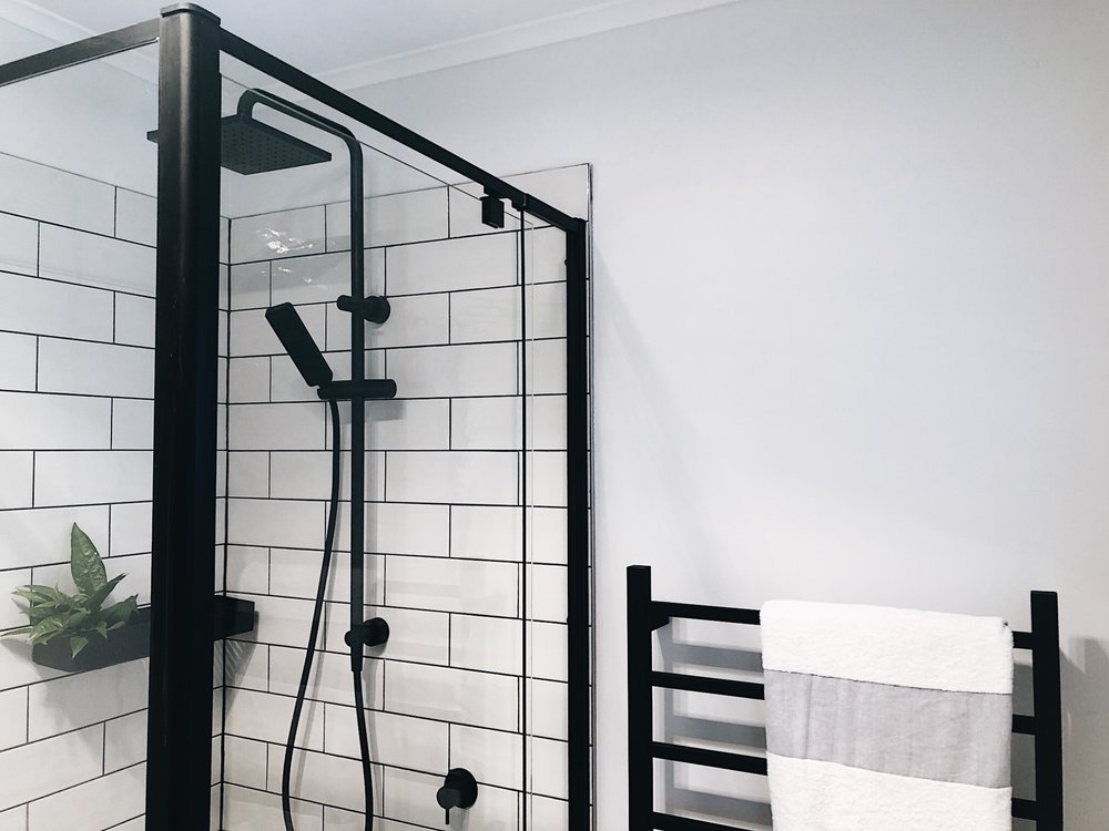 Pearson + Project The Reno Race The Rookies Bathroom Monochrome Clark Shower Rail Subway Tiles Black Shower Frame Heated Towel Rail.jpg