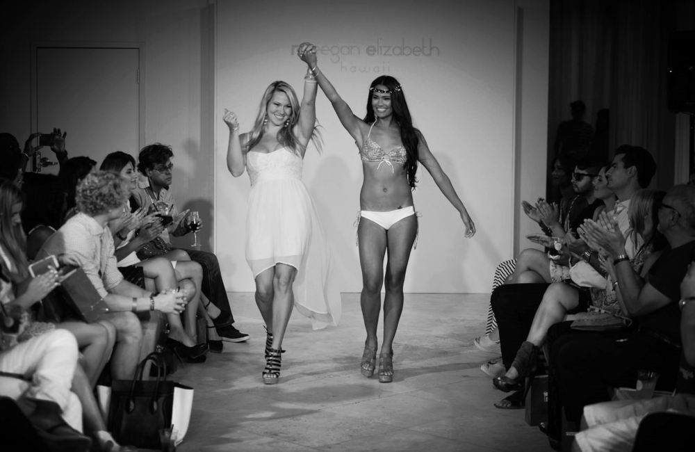 designer Meegan Elizabeth walks the runway with a model at Mercedes-Benz Fashion Week SWIM in Miami