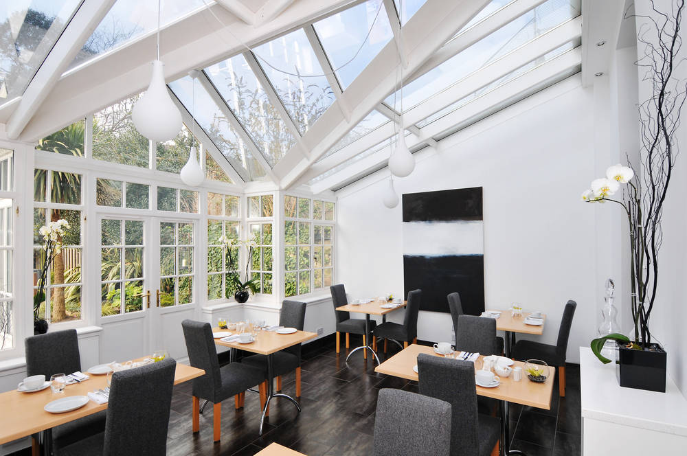 The breakfast is savoured in the cosy orangery overlooking the garden. The picture is borrwed from coolplaces.co.uk