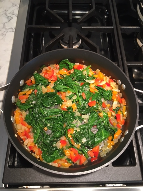 Cover for a couple minute then keep stirring, the spinach will shrink down