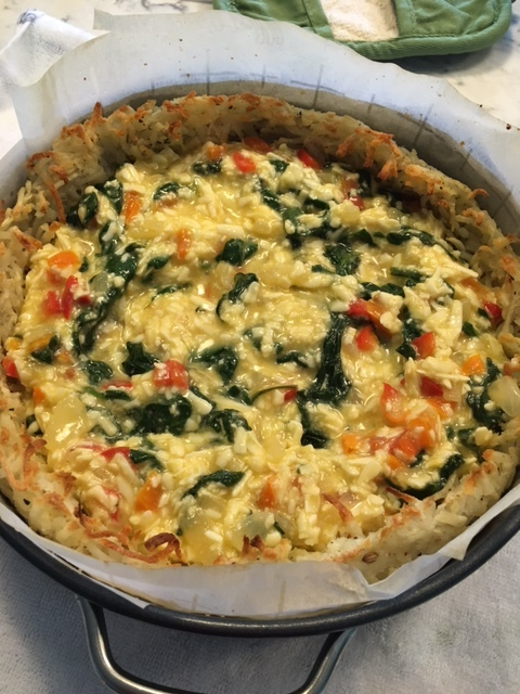 egg and veggie mixture in the pre-baked hashbrown crust