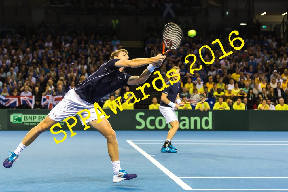SPORTS ACTION - Returning serve.JPG