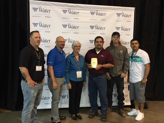 Members of our water distribution team with Director John and AZWater President Marie accepting the award for Water Distribution System of the Year: Small System.