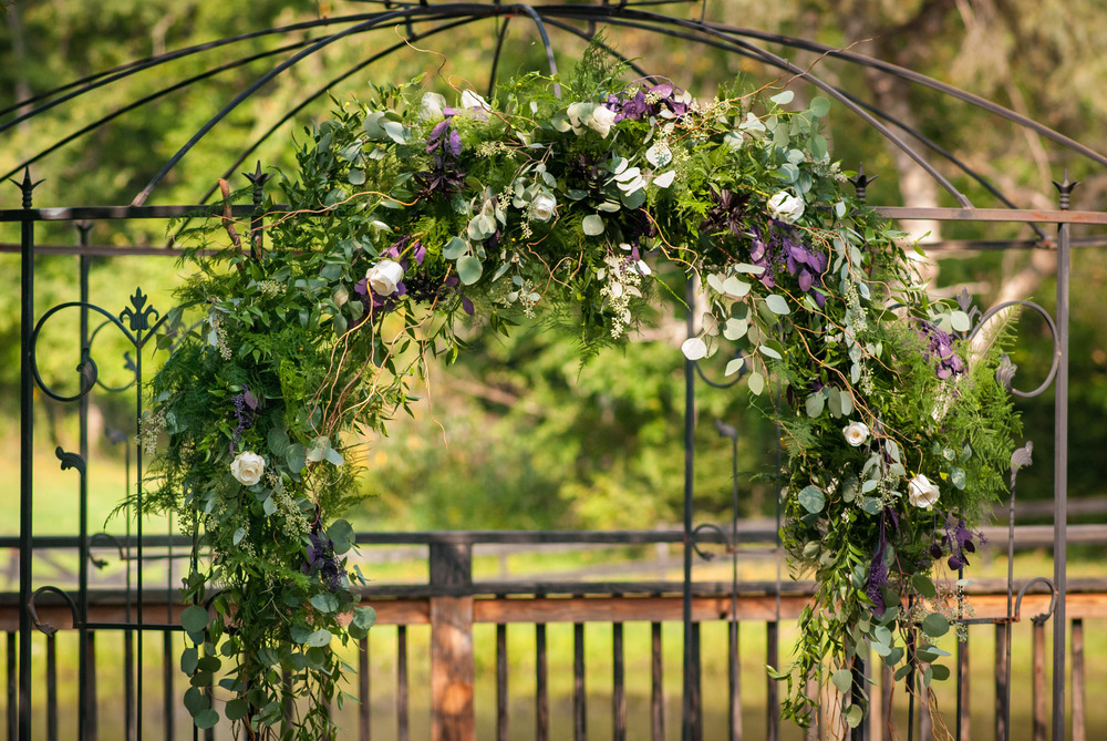 Natural Purple Florals and Greenery on Trellis (Photo Credit: Higher Focus Studios)