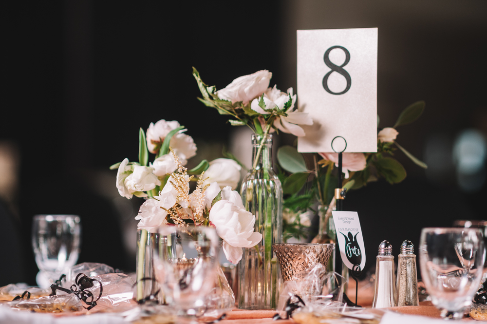Photocredit: Shannon Gray                             One of our favorite centerpiece ideas: a selection of bottles                                                                            in varying heights featuring just a few dramatic blooms.