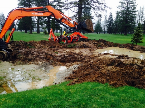 Excavating rain or shine to make course improvements. Thank  Tim and the guys on the course work crew!