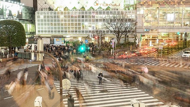 Shibuya crossing moves around me.  Long exposure 📷 by @avaalongtheway
