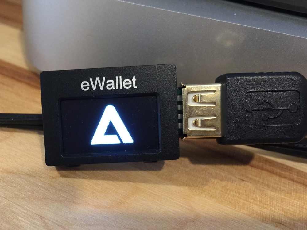 From the boot procedure, it is clear that the eWallet is NOT running a bootloader and firmware compiled by SatoshiLabs (Trezor)