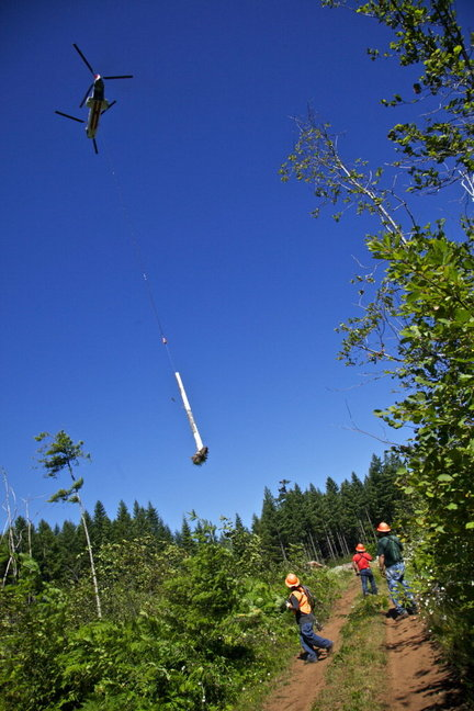 Above: Helicopter transporting woody debris in Oregon. Photo by Michael Lloyd, The Oregonian
