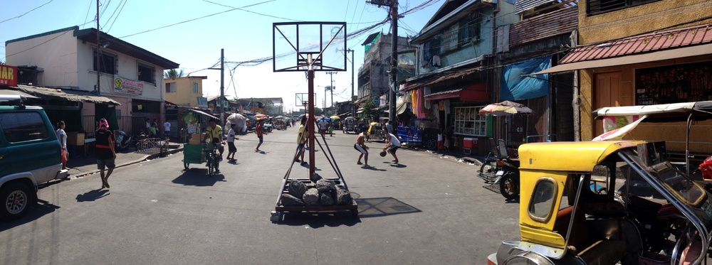 Temporary basketball court in action in Navotas.