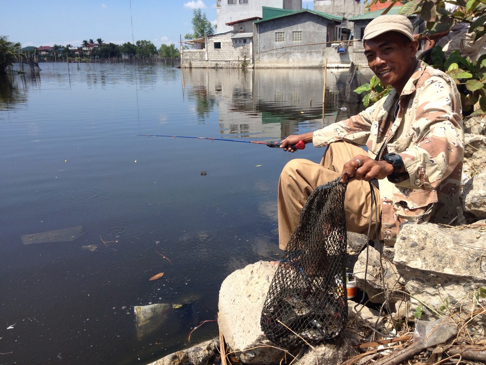 Rhonel, a fisherman from Malabon who bikes to Coloong to catch tilapia for his family.