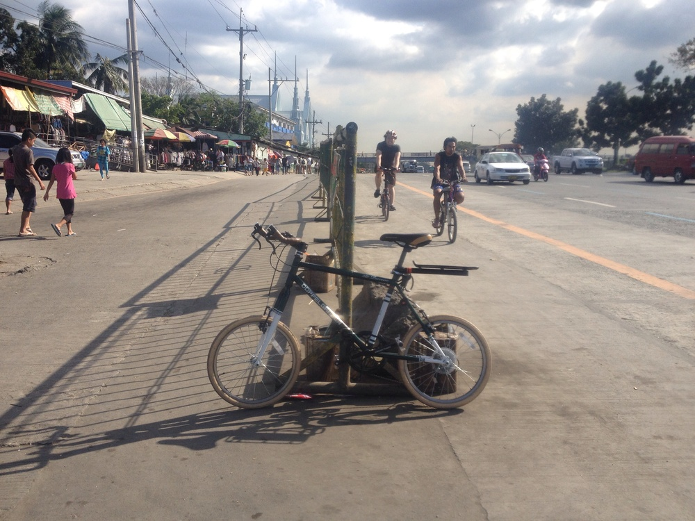 This barrier for a jeepney terminal provides an example of what a protected bike lane along commonwealth could look like. Even during a low traffic period it is still terrifying to be on the roadway as a biker.