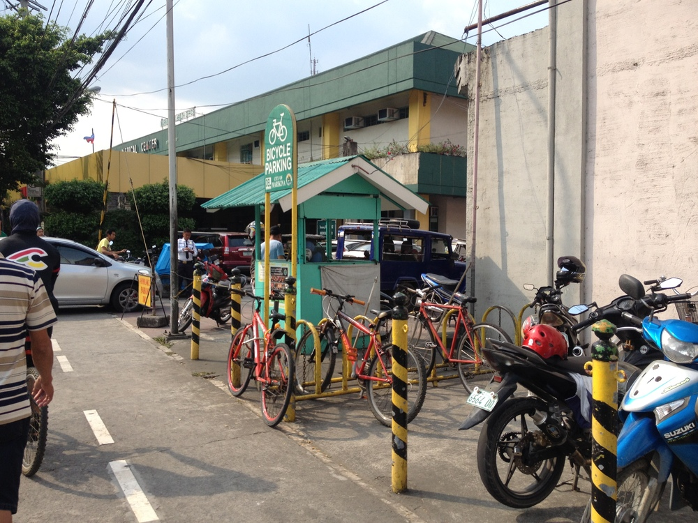The bicycle parking is near to the security stand. Whether this is intentional or not, it is a smart pairing; people feel more secure locking their bikes to stands if they are near a security post.