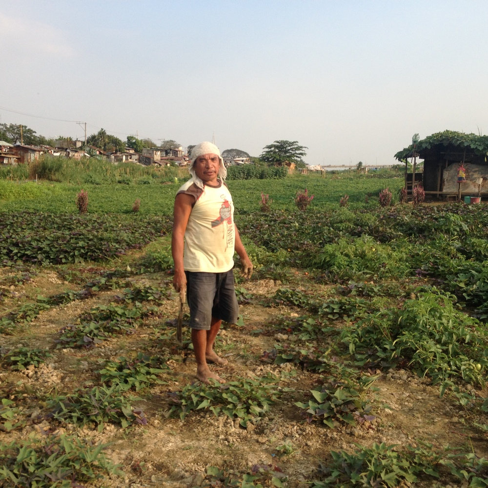The farmers, such as this man, live in the informal houses lining the road along the floodway.