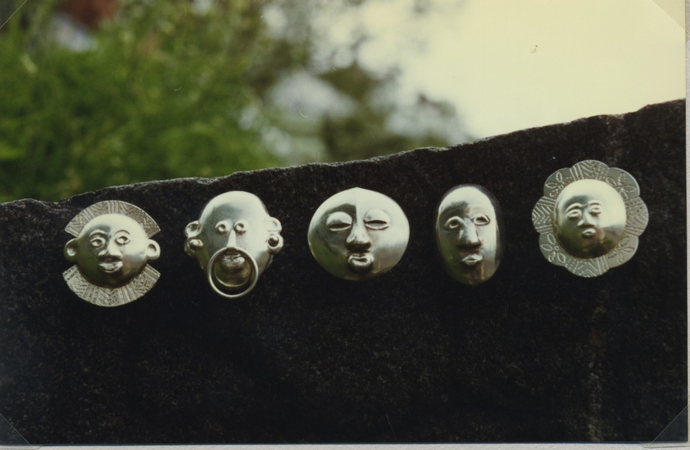 Buttons in sterling silver, inspired from african masks, chased and etched. Designed in 1995