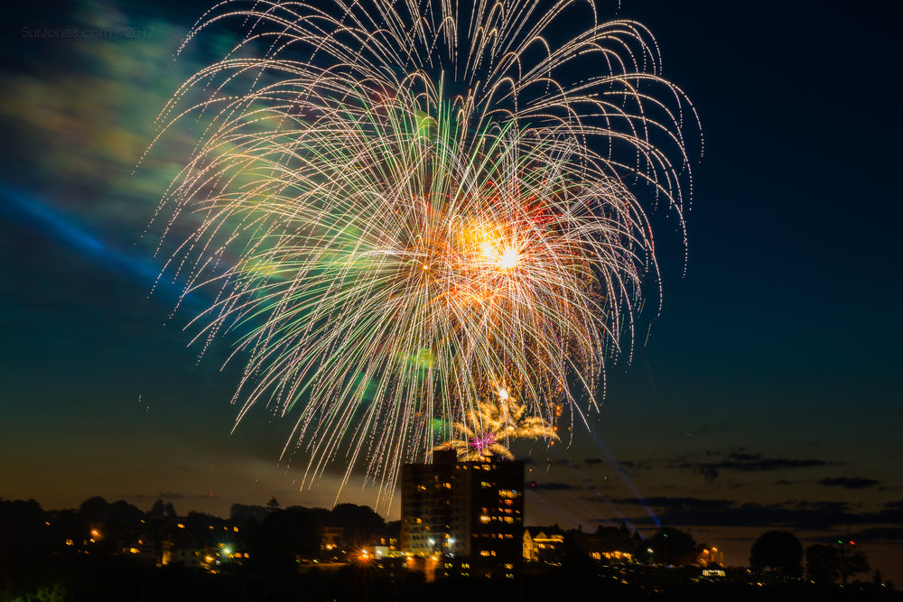 Portland Maine Photographer Captures Colorful Fireworks over the Portland Skyline just off the Atlantic Ocean