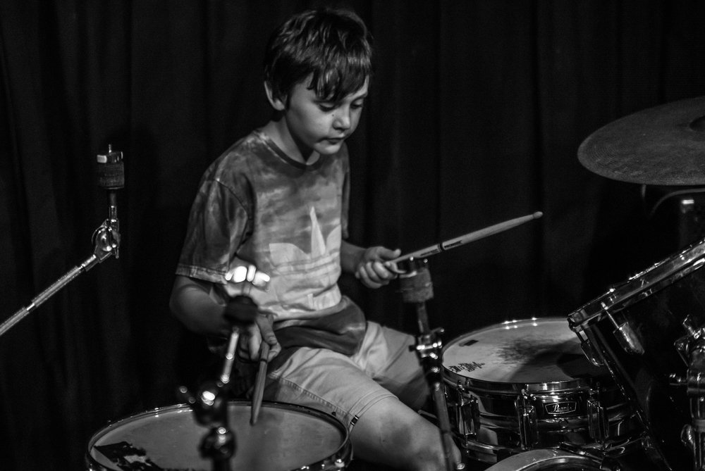 Harper playing the drums with his guitarist brother Cooper at Leaders of Rock 3 year concert.