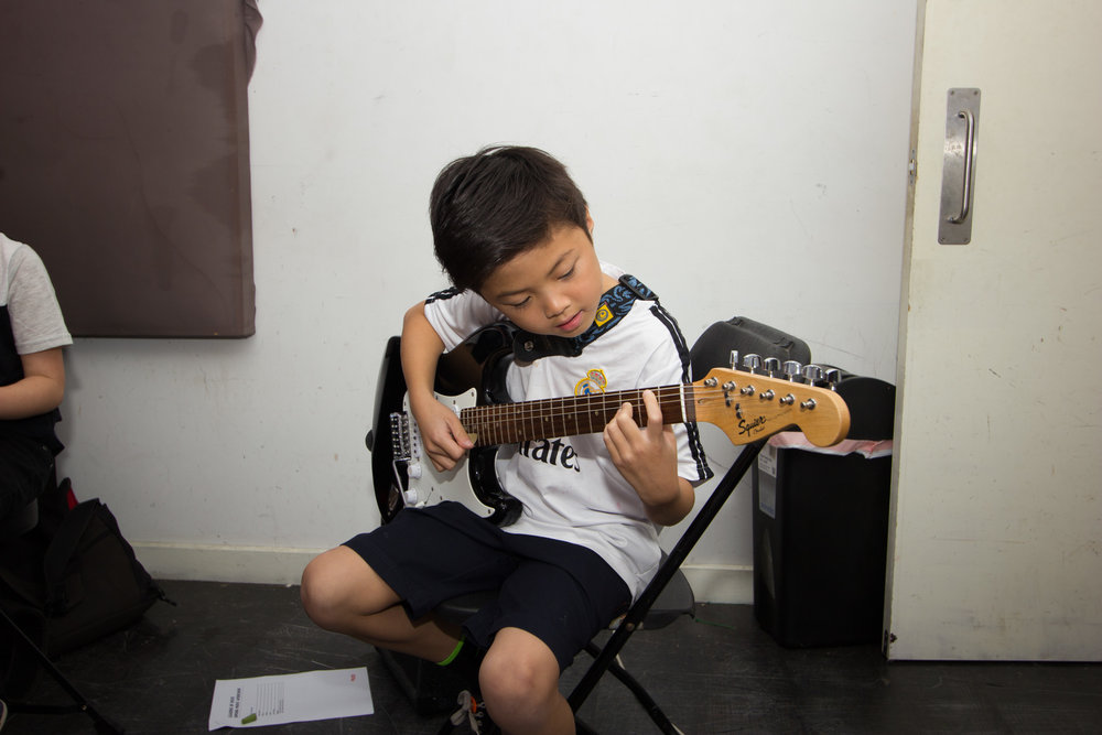 Guitar student Ethan rocking out on the electric guitar