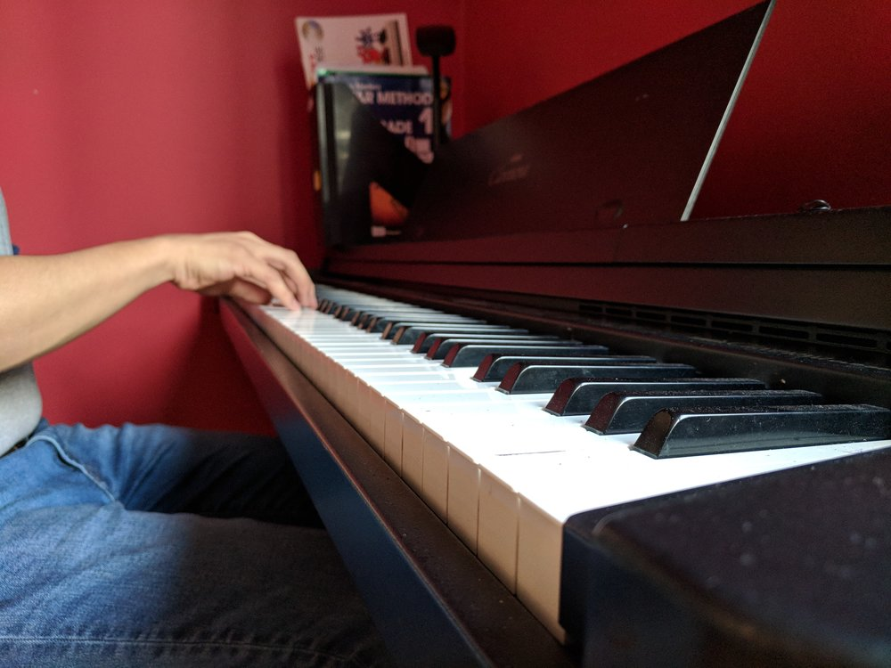 A close-up of good piano posture - notice how the fingers are not lop-sided or angled away