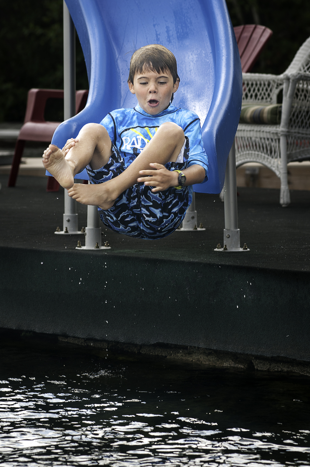 Photographed sliding at Lake Sunapee Yacht Club, Sunapee, New Hampshire