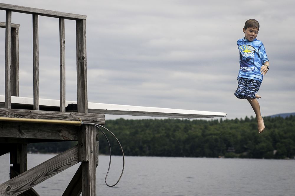 Jumping off the high diving board, Lake Sunapee Yacht Club, Sunapee, New Hampshire.