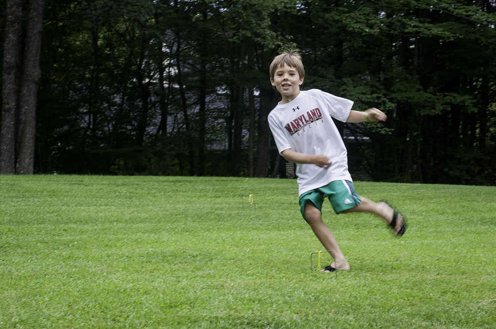Running and playing after a day of swimming in Lake Sunapee.
