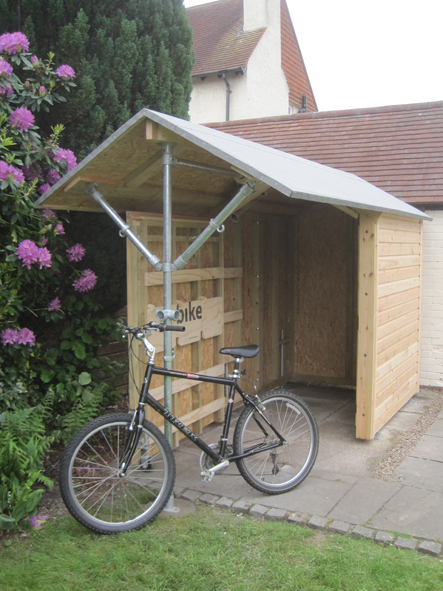 Bike shed - with unique sliding system + storage within the shed