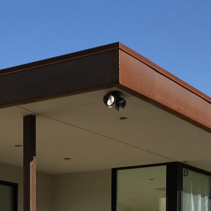 """COR-TEN® resists the corrosive effects of rain, snow, ice, fog, and other meteorological conditions by forming a coating of dark brown oxidation over the metal, which inhibits deeper penetration and negates the need for painting and costly rust-prevention maintenance over the years."" - Corten"