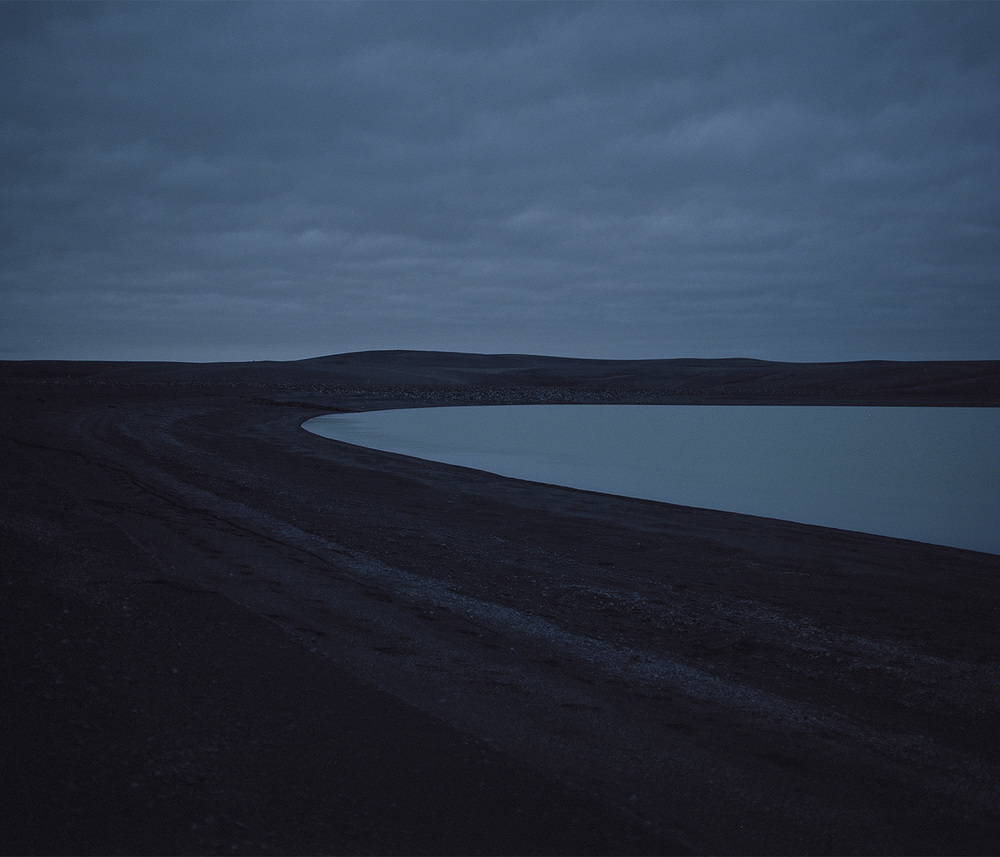 Glacial lake, black sands