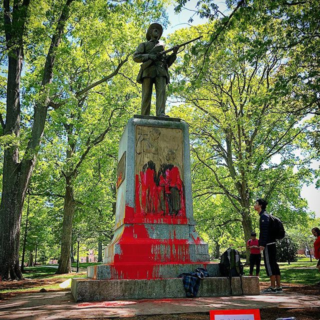 """You should see him the way that we do, at the forefront of our campus covered in our blood."" -Maya Little  While we were walking around UNC's campus today, Maya Little, a local PHD student in history, doused a confederate war monument (built during Jim Crow in 1913) in red paint and her own blood. A powerful visual to show that the statue, Silent Sam, represents the genocide of black people, as well as it being an ongoing reminder of white supremacy to black students who pass it regularly. #silentsam #blacklivesmatter #inspiration"