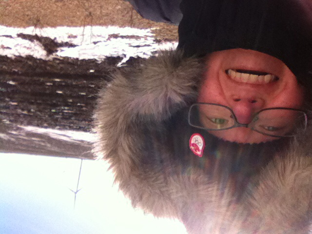 Winter walk selfie on a wind turbine service road.