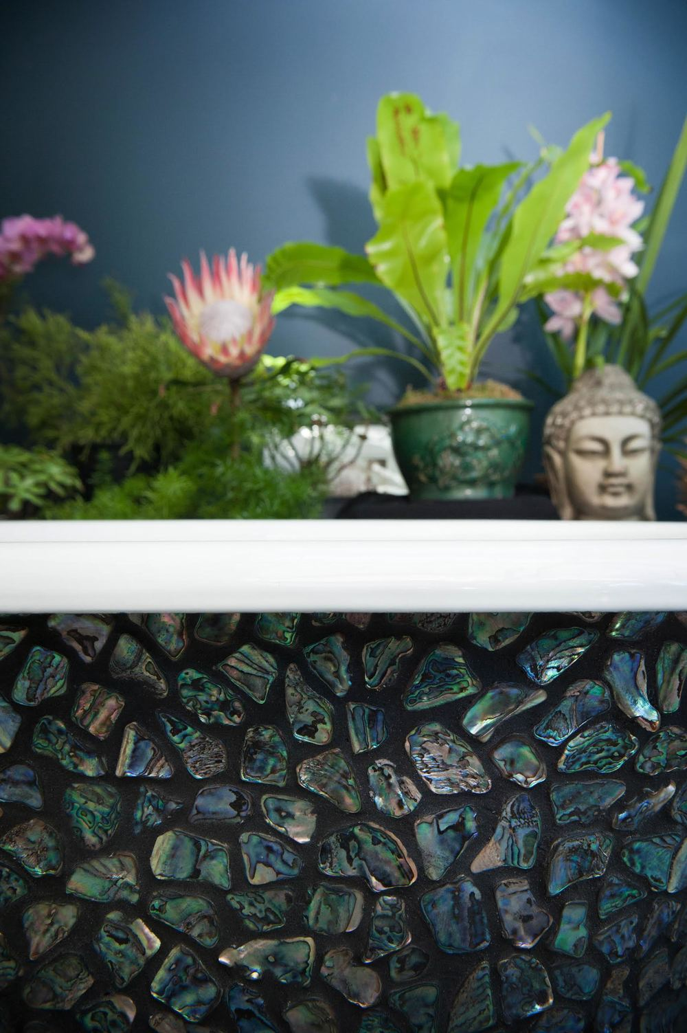 Paua shell mosaic clawfoot tub detail