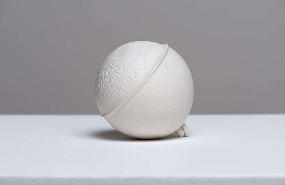 Anthony Miserendin  Navel , 2017 Gypsum cement, and porcelain dust 3 1/2 inches