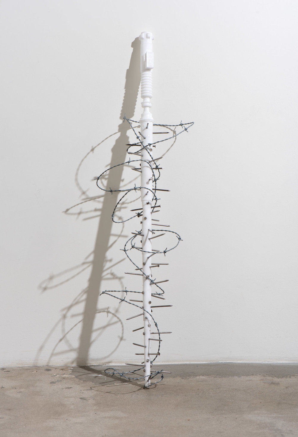 Morning Star , 2018 Urethane, pigment, nails, and barbed wire 41 x 8 x 8 inches