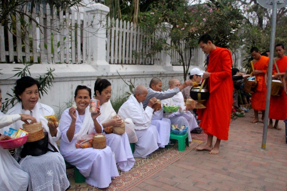 Laos alms giving