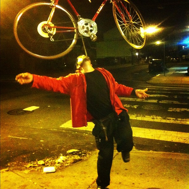 Guy balancing bike on his chin (Taken with  Instagram )