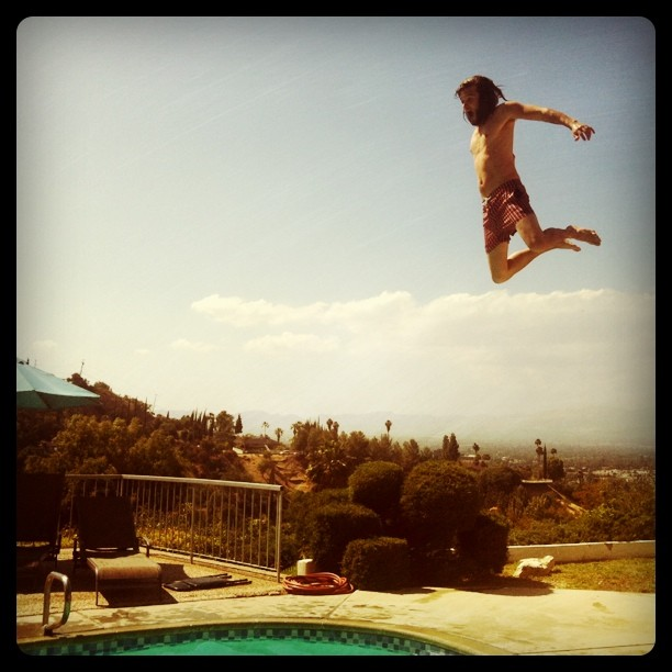 Pete jumping in the pool (Taken with Instagram at Encino, CA)